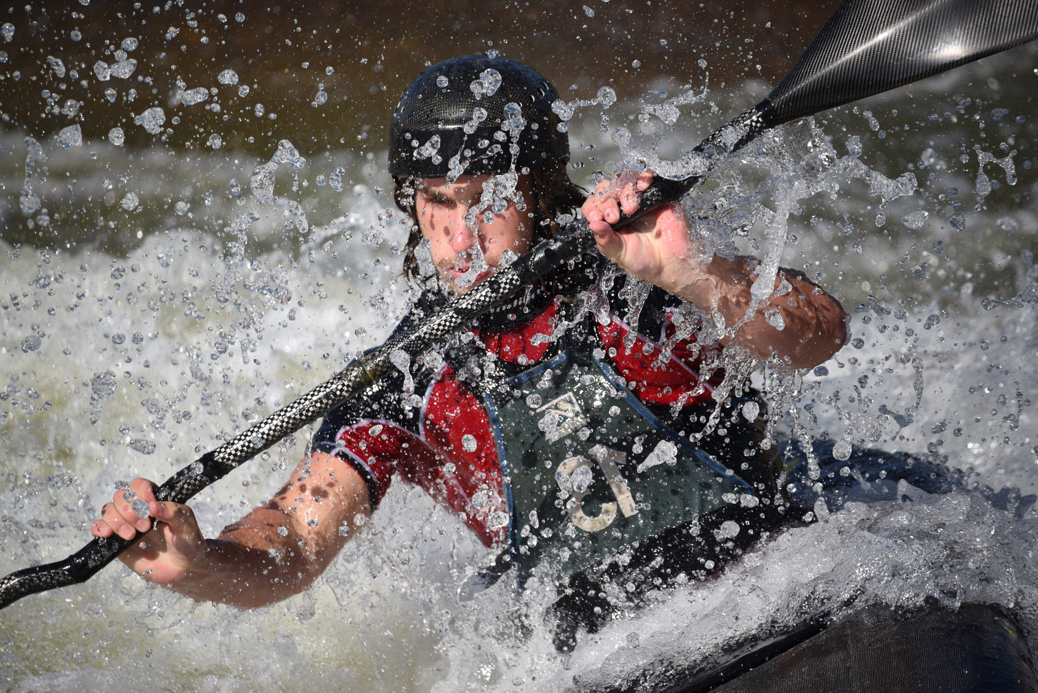 AF-P NIKKOR 70-300mm f/4.5-5.6E ED VR photo of a kayaker in white water