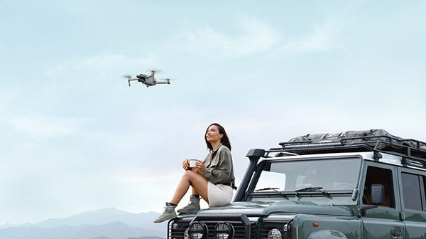 Image of drone flying over woman
