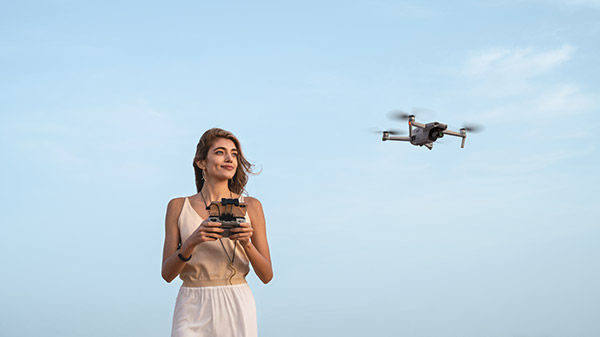 Woman in desert with drone