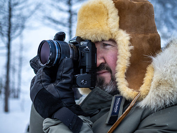 lifestyle image of man using camera
