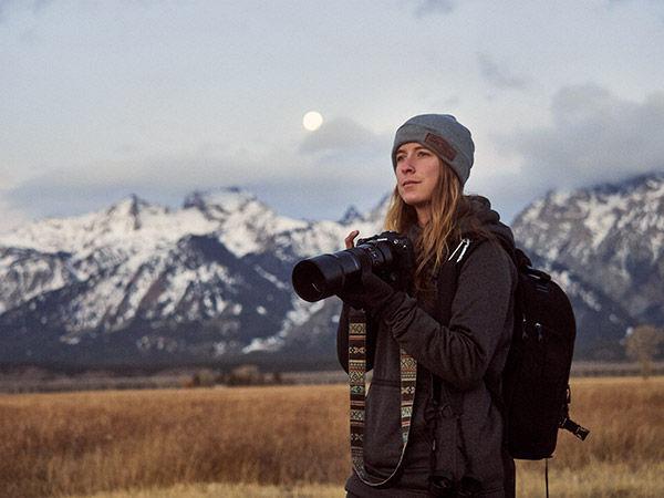 lifestyle image of woman using camera