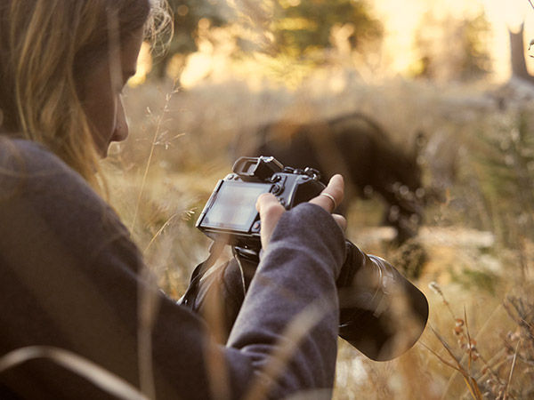 lifestyle image of woman using camera