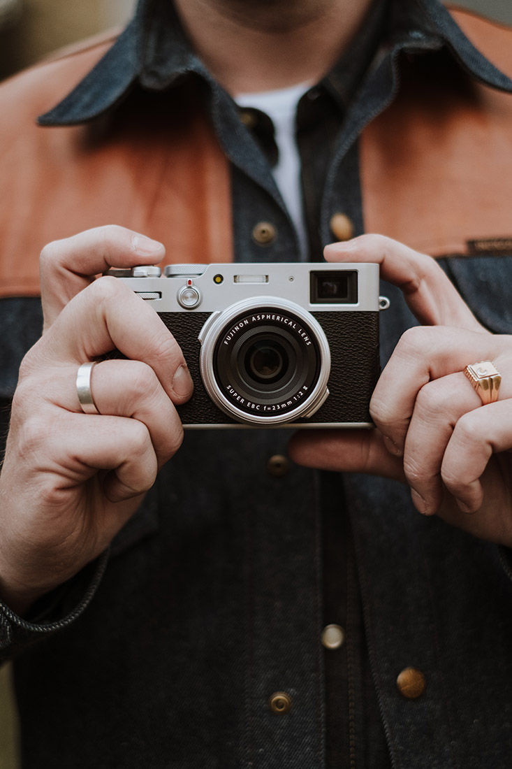 Lifestyle image of man holding camera